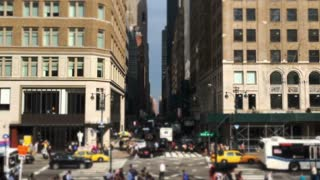 NEW YORK CITY - Circa, July, 2014 - An establishing shot of pedestrians and traffic on 5th Avenue in Manhattan.