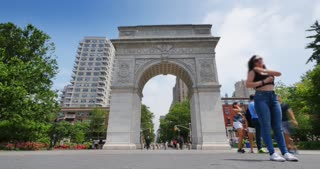 NEW YORK CITY – Circa June, 2015 – A time lapse establishing shot of Washington Square Arch in Washington Square Park in Manhattan.