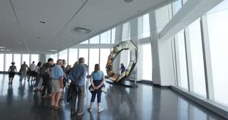 NEW YORK CITY - Circa June, 2015 - Tourists watch a multimedia presentation on the observation deck of the Freedom Tower. Editorial use only.