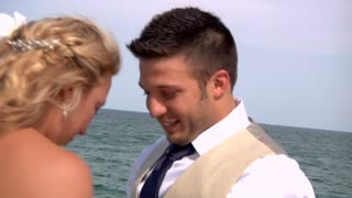 Newlyweds Kiss by the Ocean