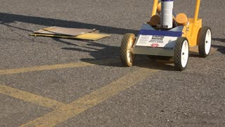 Painting new yellow lines on a parking lot.