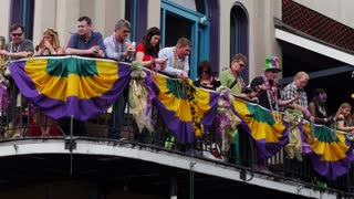 People on a Balcony During Mardi Gras 4045