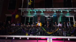 People on a Balcony on Bourbon Street During Mardi Gras 4050