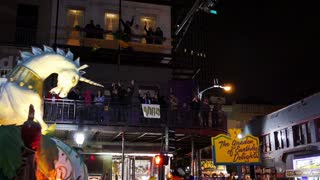People on a Mardi Gras Float Toss Beads to the People Below 4117