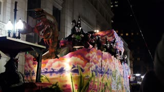 People on a Mardi Gras Parade Toss Beads to People Below 4111