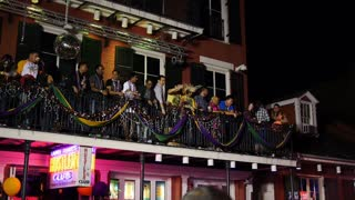 People on Bourbon Street Beg for Beads 4049