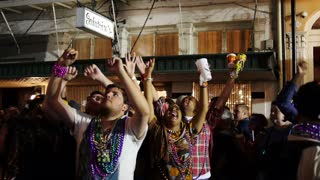 People on Bourbon Street Beg for Mardi Gras Beads 4048