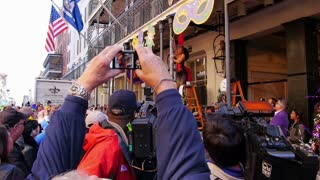 People Watch the Greasing of the Poles Festival at Mardi Gras 4085
