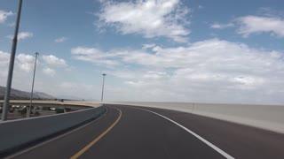 PHOENIX, AZ - Circa October, 2015 -  Merging onto a highway outside of Phoenix,  Arizona. Shot at 60fps for optional slow motion use.