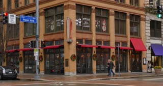 PITTSBURGH - Circa December, 2016 - An overcast establishing shot of a typical bar and restaurant decorated for the Holiday season on Penn Avenue in Pittsburgh. DX.