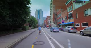 PITTSBURGH - Circa July, 2016 - Following a biker in the bicycle lane on Penn Avenue in downtown Pittsburgh.