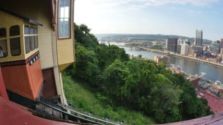 PITTSBURGH, PA - Circa August, 2014 - An establishing shot of the Monongahela Incline as it travels up and down Mount Washington near downtown Pittsburgh, PA.