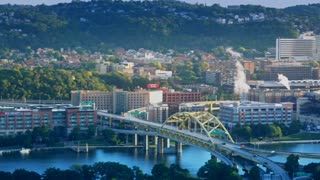 PITTSBURGH, PA - Circa, August, 2015 - A high angle establishing shot of the north shore of Pittsburgh, PA on an early summer morning.