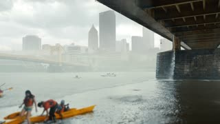 PITTSBURGH, PA - Circa May, 2015 - Kayakers desperately race to find cover under the Andy Warhol Bridge during an unexpected thunderstorm over Pittsburgh's Allegheny River.