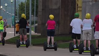 PITTSBURGH, PA - Circa September, 2015 - Tourists on Segways travel on Pittsburgh's North Shore on a late Summer evening.