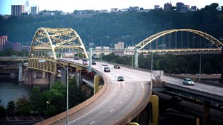 PITTSBURGH, PA - Circa September, 2015 - Traffic passes over the Fort Duquesne Bridge on a late Summer evening.