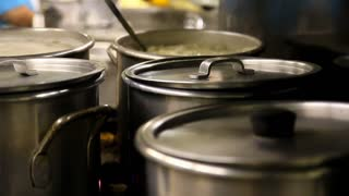 Pots Cooking on a Stove Top