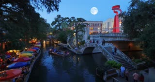 SAN ANTONIO, TX - Circa September, 2016 - A night establishing shot of the famous river walk in downtown San Antonio, Texas.