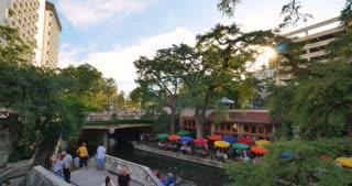 SAN ANTONIO, TX - Circa September, 2016 - An evening establishing shot of the famous river walk in downtown San Antonio, Texas.