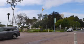 SAN DIEGO, CA - Circa February, 2017 - A daytime overcast establishing shot of traffic driving though Balboa Park in San Diego.
