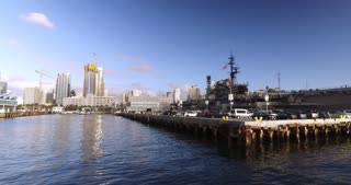 SAN DIEGO, CA - Circa February, 2017 - A dramatic establishing shot of the USS Midway Museum docked in San Diego Bay.
