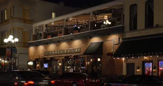 SAN DIEGO, CA - Circa February, 2017 - A dusk establishing shot of a typical upscale bar and restaurant on Fifth Avenue in San Diego's Gaslamp Quarter.