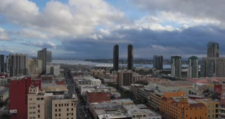 SAN DIEGO, CA - Circa February, 2017 - A high-angle timelapse view of a rain storm rolling in over the San Diego skyline.