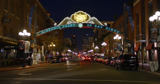SAN DIEGO, CA - Circa February, 2017 - A night time lapse view of the busy tourist attraction area of the Gaslamp Quarter in San Diego.