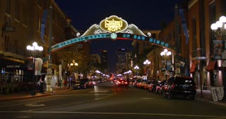 SAN DIEGO, CA - Circa February, 2017 - A nighttime establishing shot of the famous Gaslamp Quarter entrance and sign in downtown San Diego.