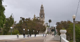 SAN DIEGO, CA - Circa February, 2017 - An overcast establishing shot of traffic passing by California Tower on El Prado in Balboa Park.