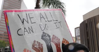 SAN DIEGO, CA - Circa February, 2017 - Protesters at the San Diego Civic Center carry signs to show their support for illegal aliens.