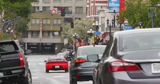 SAN DIEGO, CA - Circa February, 2017 - Traffic passes on F Street in San Diego's Gaslamp Quarter.