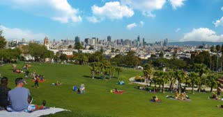SAN FRANCISCO, CA - Circa October, 2016 - A high angle rear establishing shot of Mission Dolores Park with the San Francisco skyline in the distance.