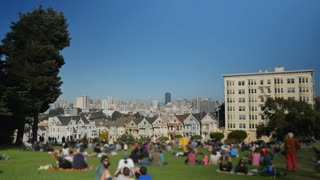 SAN FRANCISCO - Circa October, 2015 - A daytime establishing shot of the Painted Ladies victorian-style homes with the San Francisco skyline in the background.