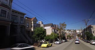 SAN FRANCISCO - Circa October, 2016 - A driver's perspective on the residential district on Castro Street in San Francisco.