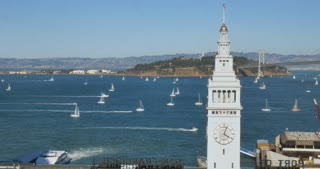 SAN FRANCISCO - Circa October, 2016 - A high angle time lapse establishing shot of boats in San Francisco Bay by the Ferry Building Clock Tower.