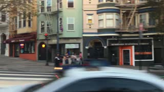 SAN FRANCISCO - Circa October, 2016 - A profile view of businesses on Market Street in San Francisco.