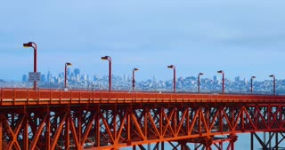 SAN FRANCISCO - Circa October, 2016 - A static profile view establishing shot of traffic on the Golden Gate Bridge with the city skyline in the distance.