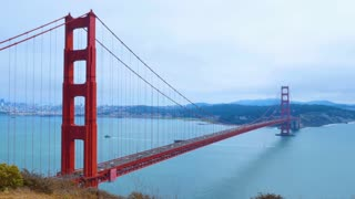 SAN FRANCISCO - Circa October, 2016 - A time lapse static establishing shot of the Golden Gate Bridge on a foggy overcast day with the city in the distance.