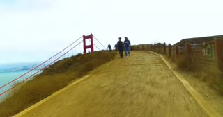 SAN FRANCISCO - Circa October, 2016 - A walking time lapse view of people visiting the Golden Gate Vista Point Overlook on a foggy overcast day.