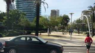 Side profile view of driving in downtown Barcelona, Spain.