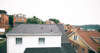 Spying into the back of a home with a drone or UAV hovering outside a window.