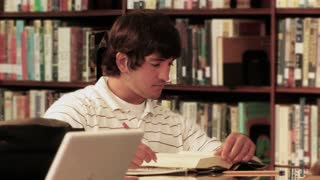 College Student Works in Library 796