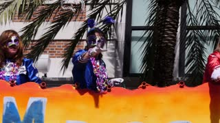 Throwing Beads from a Float in a Mardi Gras Parade 4100