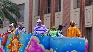 Throwing Beads from a Mardi Gras Parade Float 4092