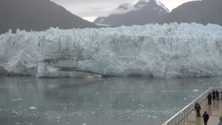 Tourists aboard a cruise ship view Margerie Glacier near Glacier Bay, Alaska.