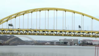 Traffic passes over the Fort Pitt Bridge over the Monongahela River in Pittsburgh, Pennsylvania.