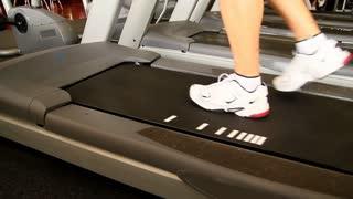 Man Walking on Treadmill in Gym