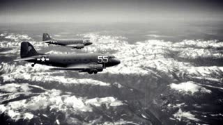 Two Douglas C-47 Skytrains fly in formation over mountainous terrain (simulation). Landscape is shot by me, and the plane is from a public domain government photograph.