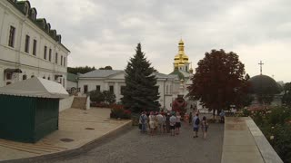 UKRAINE - Circa August, 2015 - Tourists and visitors tour the grounds of the National Kyiv-Pechersk Historical and Cultural Preserve in Kyiv, Ukraine.